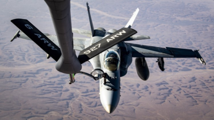 KC-135 refuels F/A-18s in support of Operation Inherent Resolve